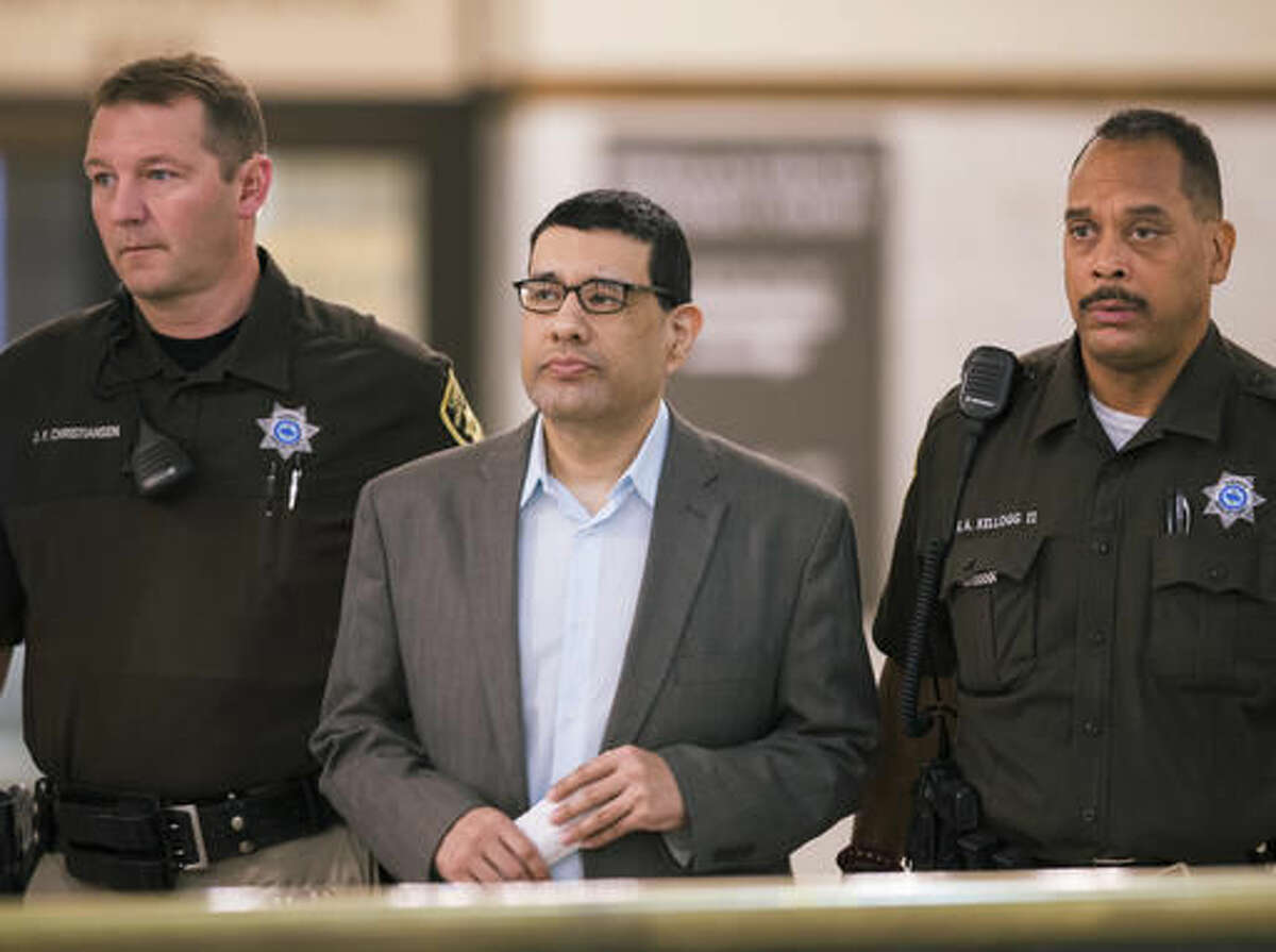 In this Sept. 27, 2016 photo, Anthony Garcia is led by deputies at the Douglas County Court in Omaha, Neb. Closing arguments are taking place Tuesday, Oct. 25, 2016, in his trial. Garcia, a former doctor, is accused of killing four people with ties to the Creighton medical school that fired him in 2001. (AP Photo/Nati Harnik)