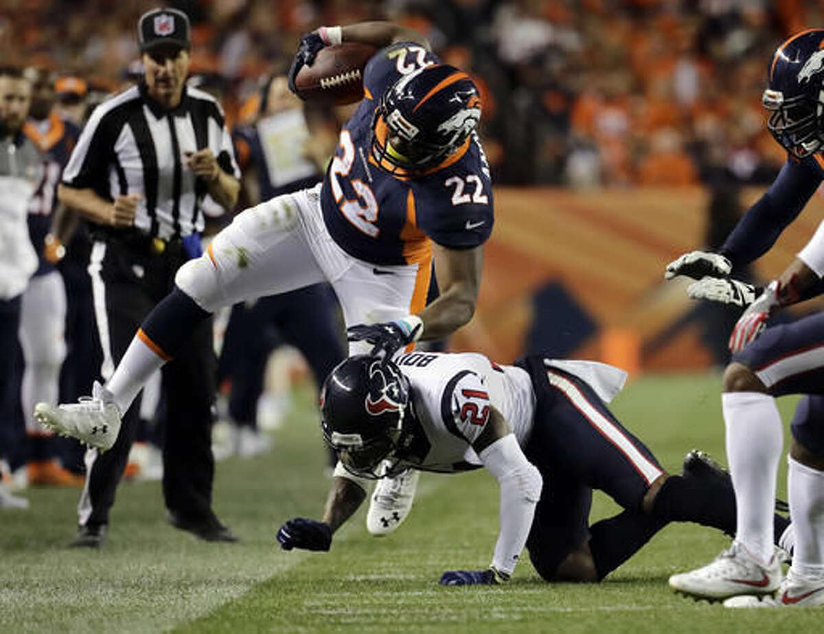Denver Broncos running back C.J. Anderson (22) is hit out of bounds by Houston Texans cornerback A.J. Bouye (21) during the second half of an NFL football game, Monday, Oct. 24, 2016, in Denver. (AP Photo/Jack Dempsey)