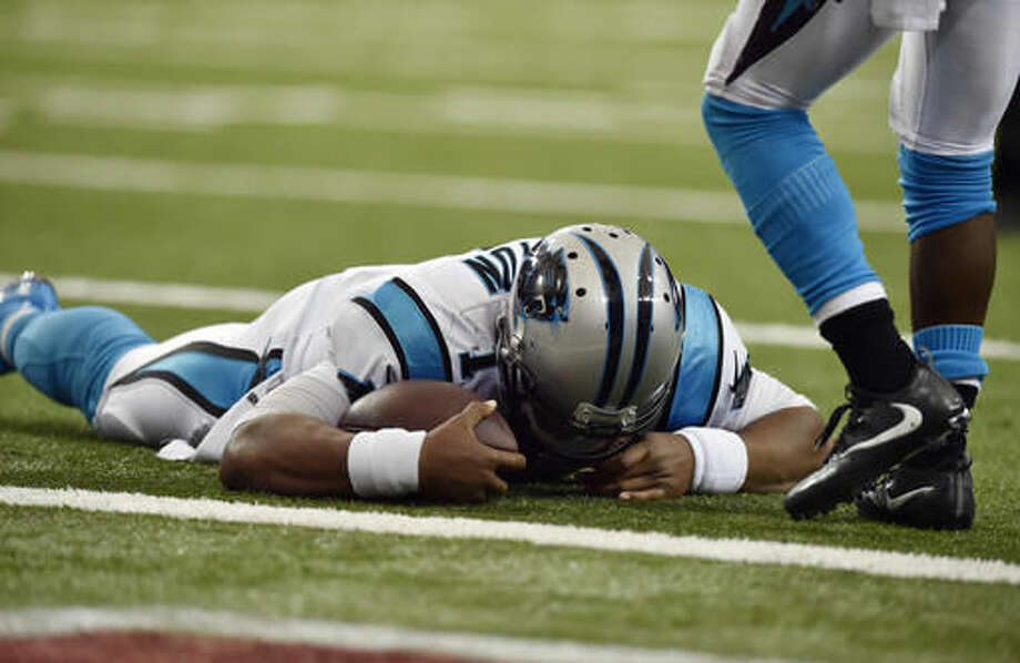 FILE - In this Oct. 2, 2016, file photo, Carolina Panthers quarterback Cam Newton (1) lies on the turf after a hit during a two-point conversion against the Atlanta Falcons in the second half of an NFL football game in Atlanta. Newton said his first concussion, which occurred Oct. 2 against the Falcons, was preventable. (AP Photo/Rainier Ehrhardt, File)