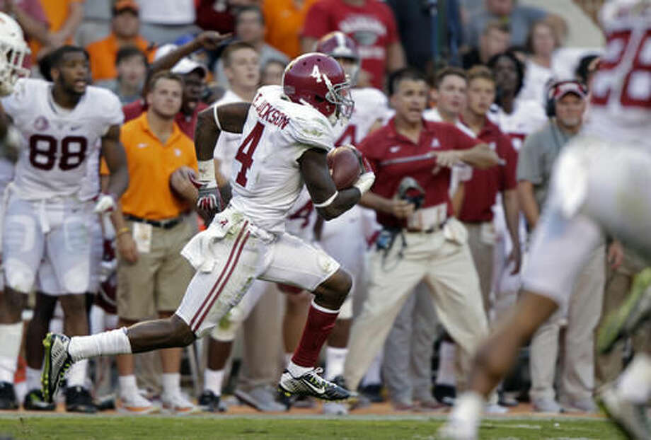 FILE - In this Saturday, Oct. 15, 2016, file photo, Alabama defensive back Eddie Jackson (4) returns a punt for a 79-yard touchdown during the second half of an NCAA college football game against Tennessee in Knoxville, Tenn. There's not always a right-or-wrong answer to the question of whether they should stay or should they go, even with hindsight. Just ask Jackson, the Crimson Tide's All-American safety who elected to bypass the NFL Draft following last season and return for his senior year, only to have that season cut short by a broken left leg last week. (AP Photo/Wade Payne, File)