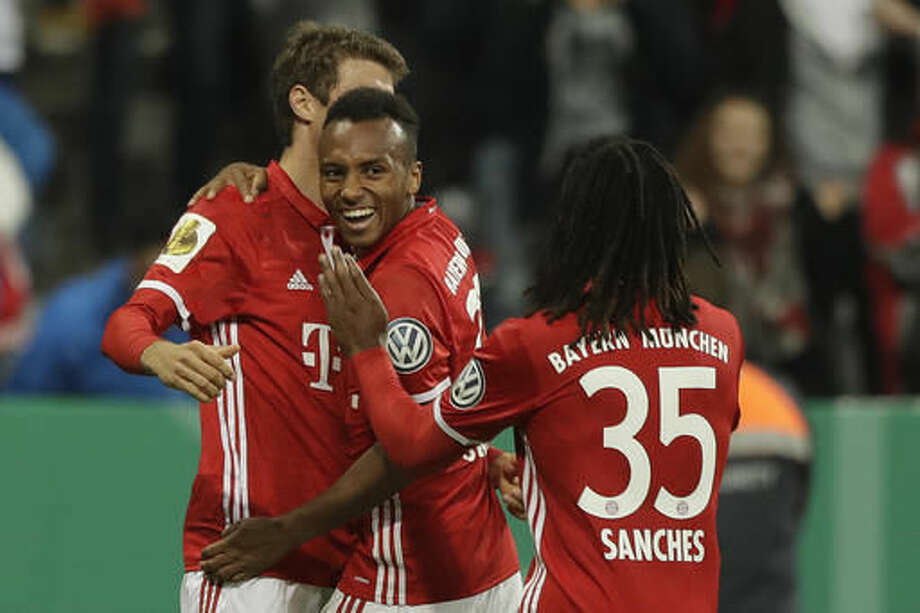Bayern's Julian Green, center, celebrates with teammates Thomas Mueller, rear, and Renato Sanchez after scoring his side's second goal during the German Soccer Cup match between FC Bayern Munich and FC Augsburg at Allianz Arena stadium in Munich, Germany, Wednesday, Oct. 26, 2016. (AP Photo/Matthias Schrader)
