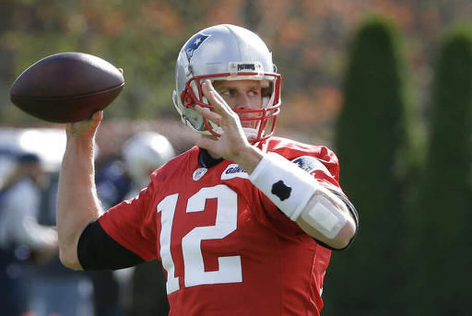 New England Patriots quarterback Tom Brady (12) winds up for a pass during an NFL football team practice Wednesday, Oct. 26, 2016, in Foxborough, Mass. (AP Photo/Steven Senne)