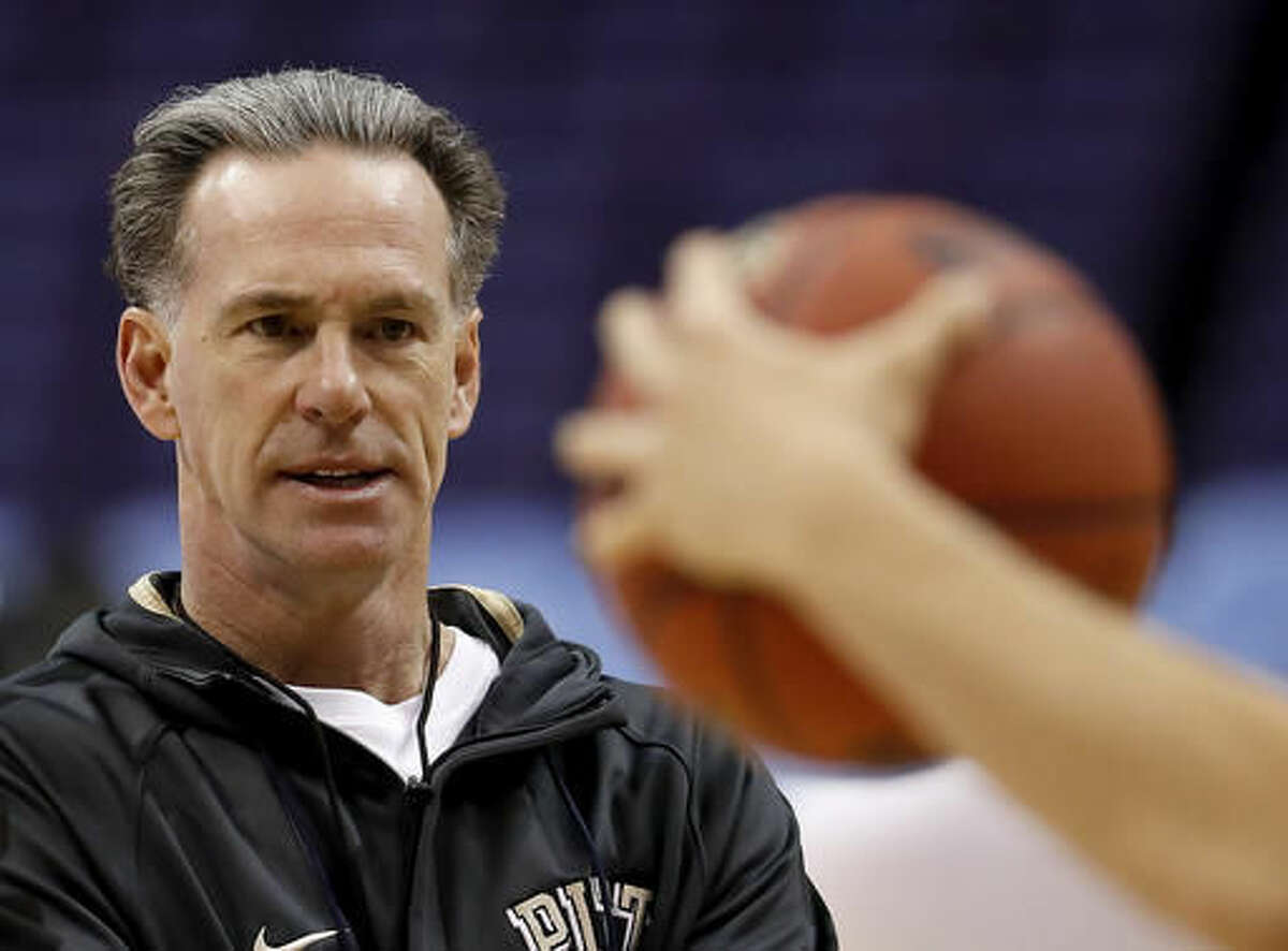 FILE - In this March 17, 2016 file photo, Pittsburgh head coach Jamie Dixon watches practice ahead of a first-round men's college basketball game in the NCAA tournament in St. Louis. Dixon was part of two Southwest Conference titles as a TCU player three decades ago. Dixon, who won 328 games the past 13 seasons at Pittsburgh, is now back at his alma mater as head coach.(AP Photo/Charlie Riedel, File)