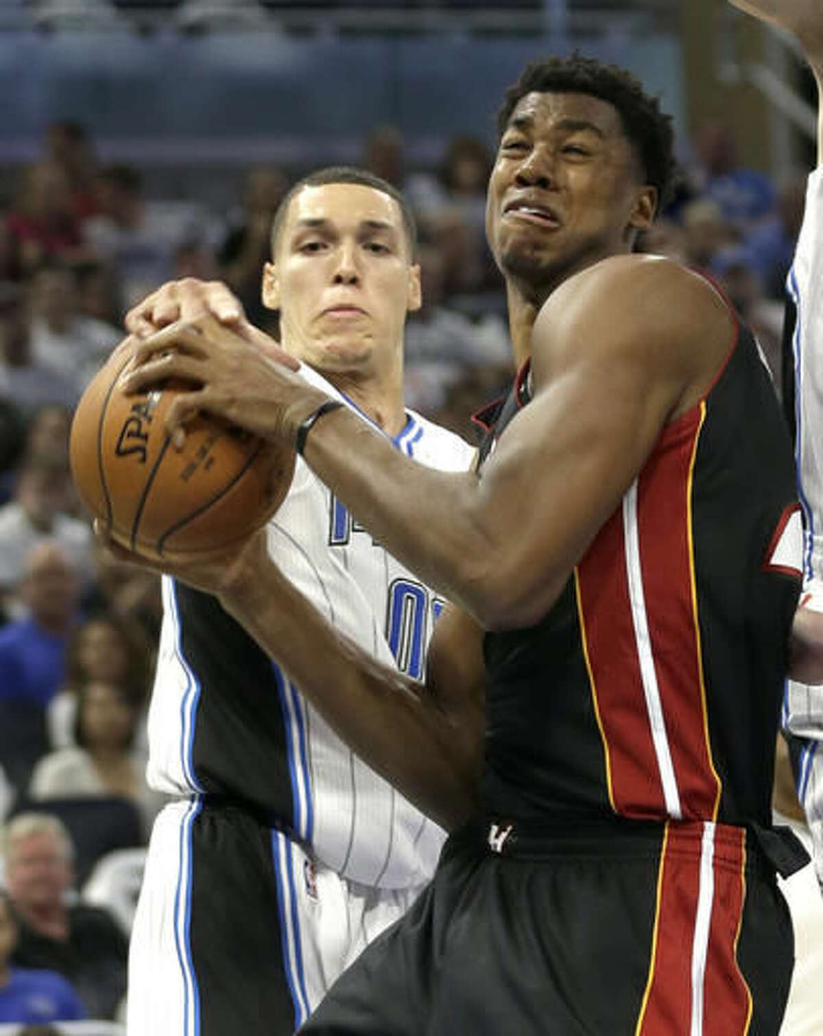 Miami Heat's Hassan Whiteside, right, struggles to get off a shot as Orlando Magic's Aaron Gordon, left, gets his hand on the ball during the first half of an NBA basketball game, Wednesday, Oct. 26, 2016, in Orlando, Fla. (AP Photo/John Raoux)