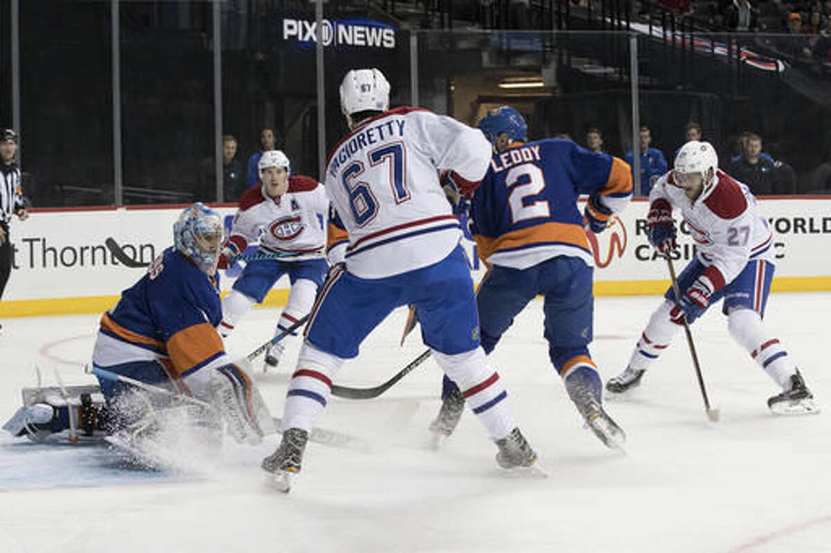 New York Islanders goalie Thomas Greiss (1) blocks a shot by Montreal Canadiens center Alex Galchenyuk (27) during the first period of an NHL hockey game Wednesday, Oct. 26, 2016 in New York. (AP Photo/Mary Altaffer)