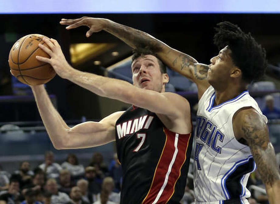 Miami Heat's Goran Dragic (7) goes up for a shot against Orlando Magic's Elfrid Payton (4) during the first half of an NBA basketball game, Wednesday, Oct. 26, 2016, in Orlando, Fla. (AP Photo/John Raoux)