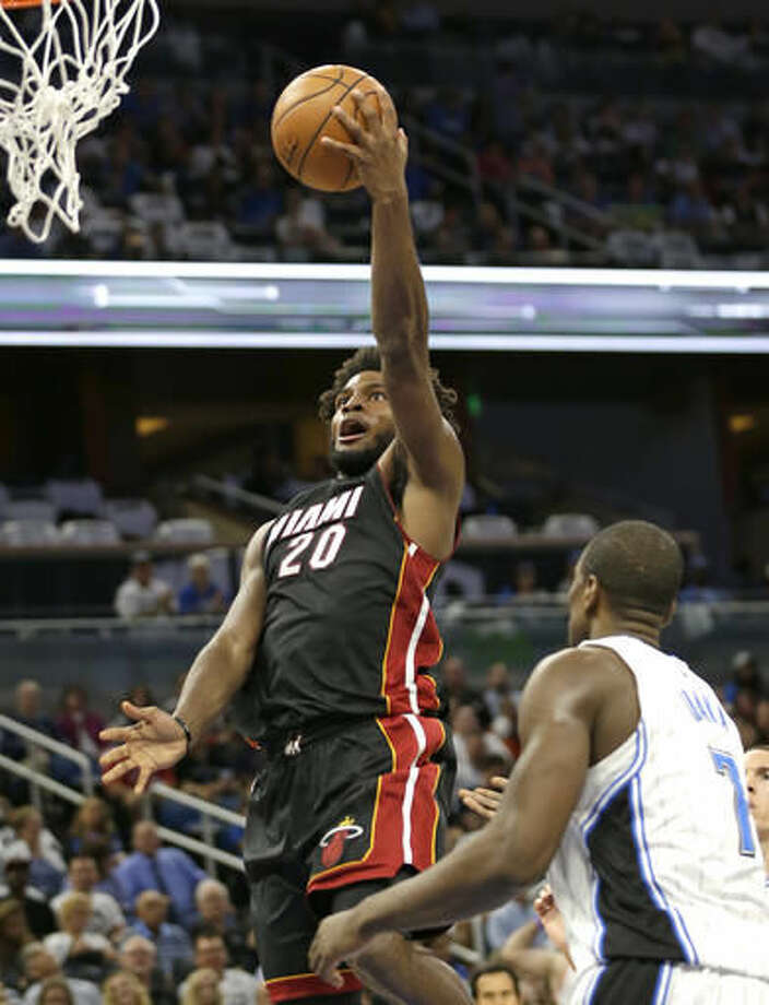 Miami Heat's Justise Winslow (20) goes up for a shot over Orlando Magic's Serge Ibaka (7) during the first half of an NBA basketball game, Wednesday, Oct. 26, 2016, in Orlando, Fla. (AP Photo/John Raoux)