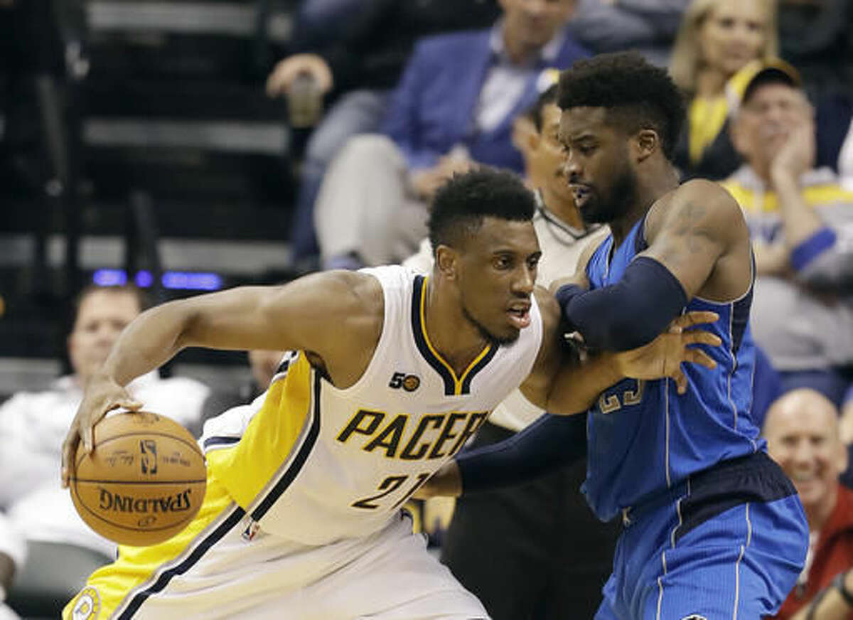 Indiana Pacers' Thaddeus Young goes to the basket against Dallas Mavericks' Wesley Matthews during the first half of an NBA basketball game Wednesday, Oct. 26, 2016, in Indianapolis. (AP Photo/Darron Cummings)