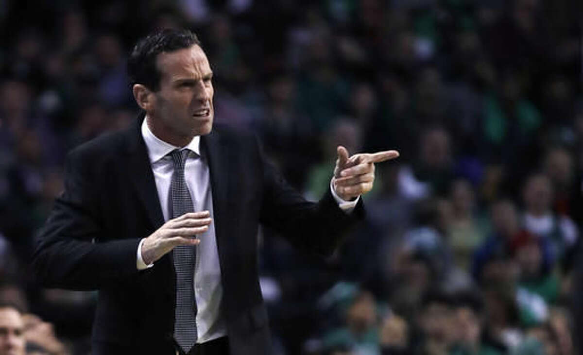 Brooklyn Nets head coach Kenny Atkinson calls to his players during the first quarter of an NBA basketball game against the Boston Celtics in Boston, Wednesday, Oct. 26, 2016. (AP Photo/Charles Krupa)