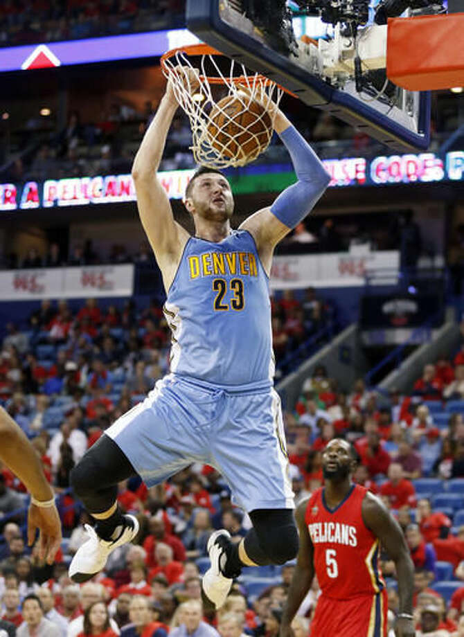 Denver Nuggets center Jusuf Nurkic (23) slam dunks in the first half of an NBA basketball game against the New Orleans Pelicans in New Orleans, Wednesday, Oct. 26, 2016. (AP Photo/Gerald Herbert)