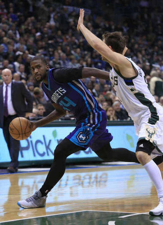 Charlotte Hornets forward Michael Kidd-Gilchrist, left, is defended by Milwaukee Bucks guard Matthew Dellavedova, right, during the first half of an NBA basketball game Wednesday, Oct. 26, 2016, in Milwaukee. (AP Photo/Darren Hauck)