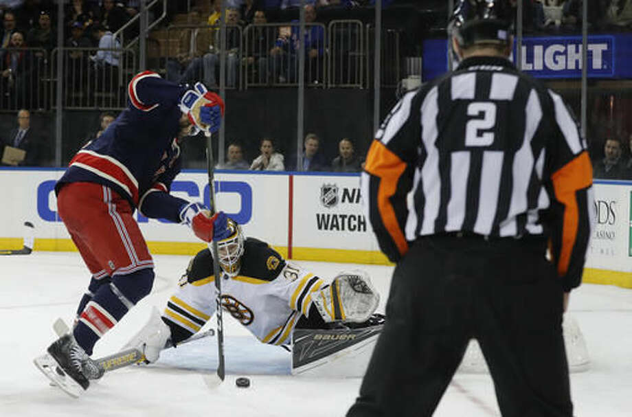 New York Rangers right wing Rick Nash, left, goes after a rebound to score on Boston Bruins goalie Zane McIntyre (31) during the second period of an NHL hockey game, Wednesday, Oct. 26, 2016, in New York. (AP Photo/Julie Jacobson)
