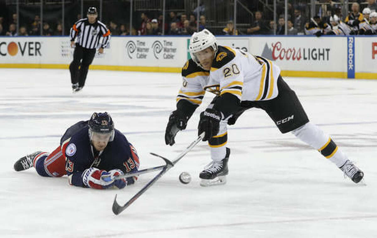 New York Rangers center Kevin Hayes (13) and Boston Bruins center Riley Nash (20) vie for the puck during the second period of an NHL hockey game, Wednesday, Oct. 26, 2016, in New York. (AP Photo/Julie Jacobson)