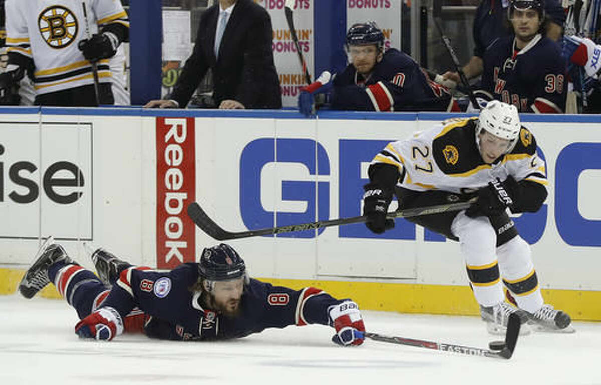 New York Rangers defenseman Kevin Klein (8) hits the ice to keep the puck from Boston Bruins center Austin Czarnik (27) during the first period of an NHL hockey game, Wednesday, Oct. 26, 2016, in New York. (AP Photo/Julie Jacobson)