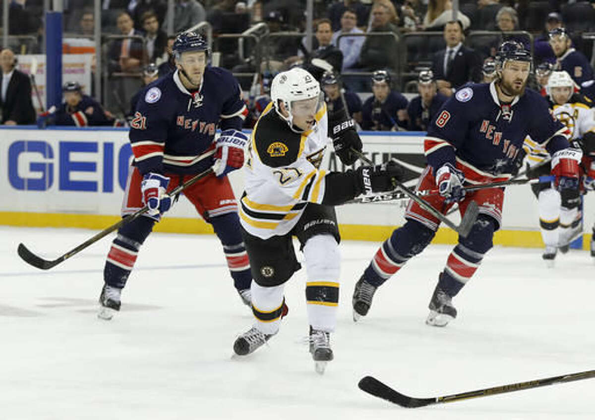 Boston Bruins center Austin Czarnik (27) shoots and scores a goal against the New York Rangers during the first period of an NHL hockey game, Wednesday, Oct. 26, 2016, in New York. (AP Photo/Julie Jacobson)