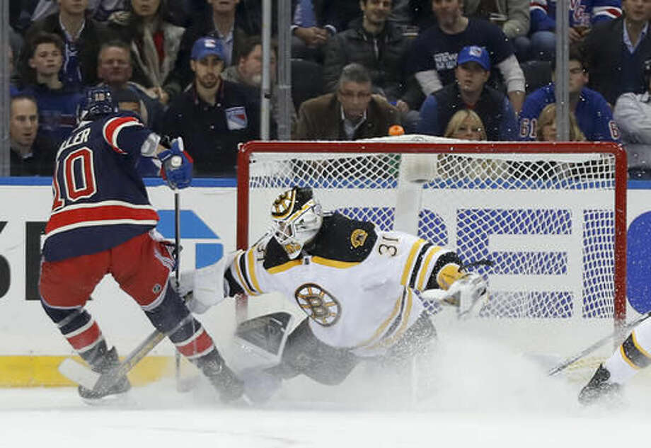 Boston Bruins goalie Zane McIntyre (31) makes a save on a shot by New York Rangers left wing J.T. Miller (10) during the first period of an NHL hockey game, Wednesday, Oct. 26, 2016, in New York. (AP Photo/Julie Jacobson)