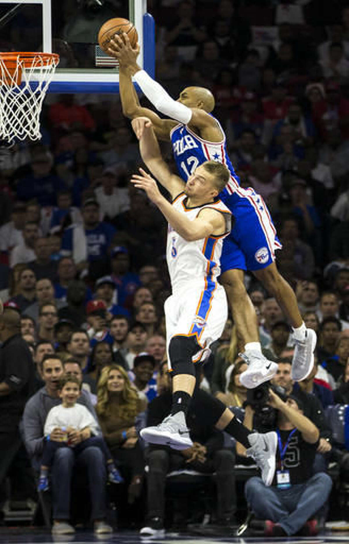 Philadelphia 76ers' Gerald Henderson, right, goes up for the shot over Oklahoma City Thunder's Domantas Sabonis, left, during the first half of an NBA basketball game, Wednesday, Oct. 26, 2016, in Philadelphia. (AP Photo/Chris Szagola)