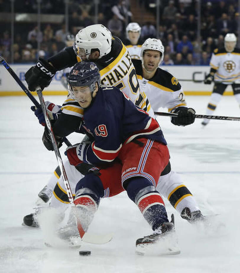 New York Rangers right wing Jesper Fast (19) seals off Boston Bruins center Tim Schaller (59) from the puck during the first period of an NHL hockey game, Wednesday, Oct. 26, 2016, in New York. (AP Photo/Julie Jacobson)