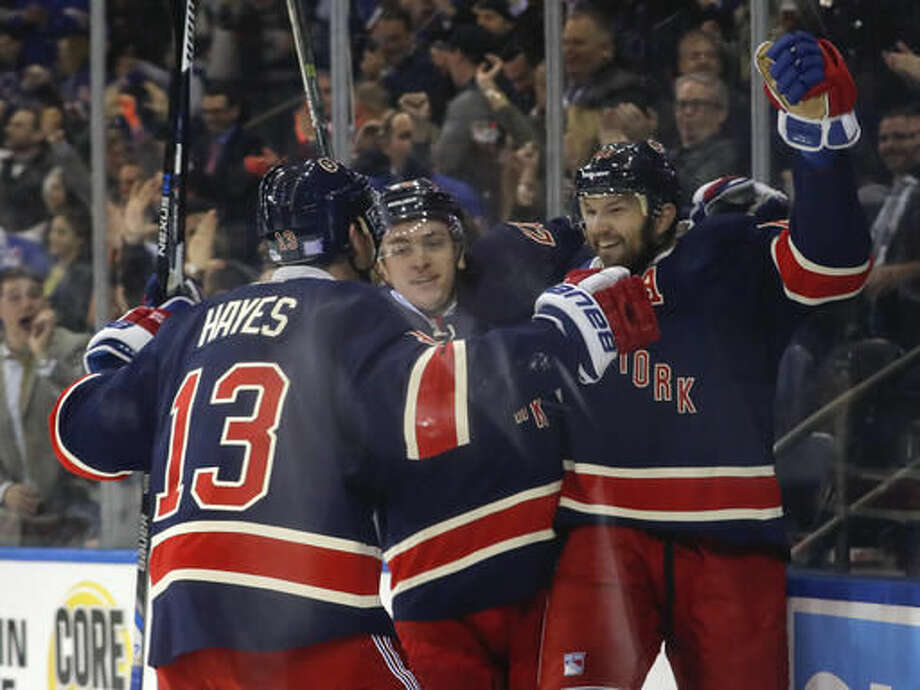 New York Rangers right wing Rick Nash, right, celebrates with left wing Jimmy Vesey, center, and center Kevin Hayes (13) after scoring a goal against the Boston Bruins during the second period of an NHL hockey game, Wednesday, Oct. 26, 2016, in New York. (AP Photo/Julie Jacobson)