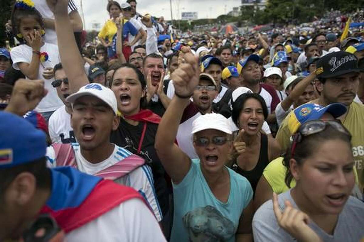 People protest against Venezuela's President Nicolas Maduro in Caracas, Venezuela, Wednesday, Oct. 26, 2016. Venezuela's standoff deepened after congress voted to open a political trial against Maduro for breaking the constitutional order and opposition leaders called for mass demonstrations on Wednesday to drive the leader from office. (AP Photo/Alejandro Cegarra)