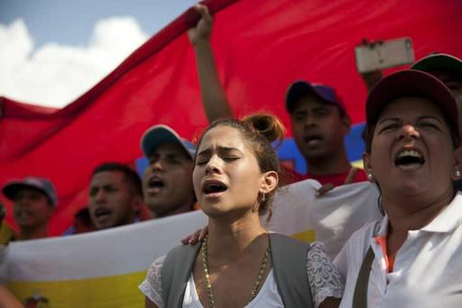 Women chant anti-government slogans during a protest against Venezuela's President Nicolas Maduro in Caracas, Venezuela, Wednesday, Oct. 26, 2016. Venezuela's standoff deepened after congress voted to open a political trial against Maduro for breaking the constitutional order and opposition leaders called for mass demonstrations to drive the leader from office. (AP Photo/Rodrigo Abd)