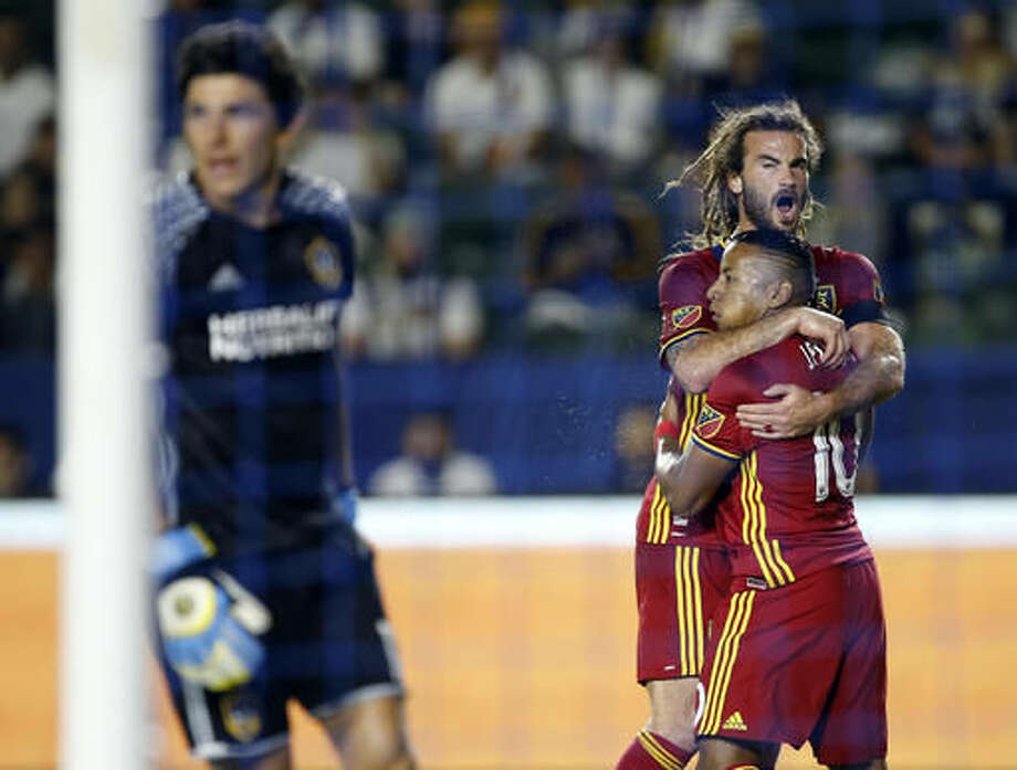 Real Salt Lake midfielder Kyle Beckerman, second right, celebrates a goal by forward Joao Plata (10) on a penalty kick against Los Angeles Galaxy goalkeeper Brian Rowe, left, during the first half of a knockout round MLS playoff soccer match in Carson, Calif., Wednesday, Oct. 26, 2016. (AP Photo/Alex Gallardo)