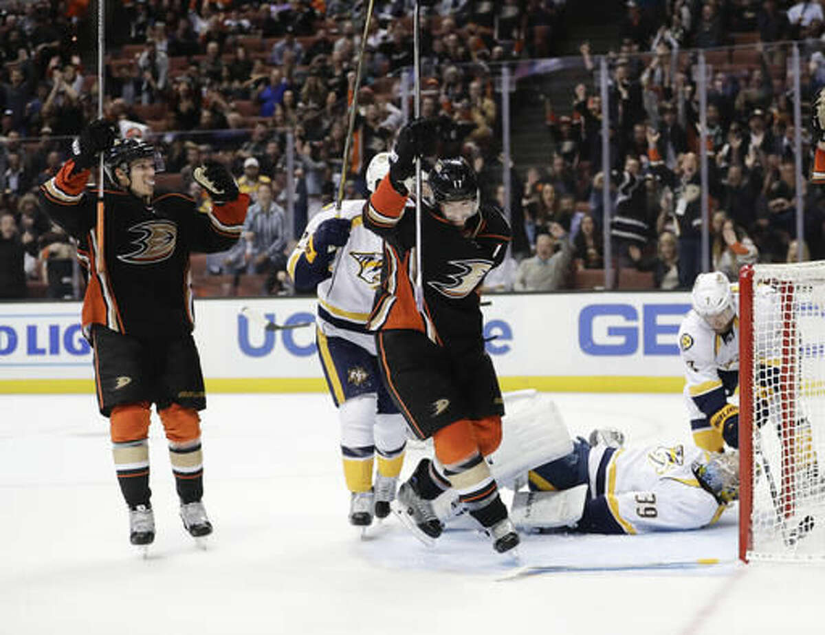 Anaheim Ducks' Ryan Kesler (17) and Jakob Silfverberg (33) celebrate a goal by Cam Fowler as they skate past Nashville Predators goalie Marek Mazanec, of the Czech Republic, during the second period of an NHL hockey game Wednesday, Oct. 26, 2016, in Anaheim, Calif. (AP Photo/Jae C. Hong)
