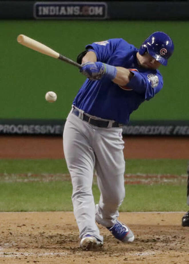 Chicago Cubs' Kyle Schwarber hits a RBI single against the Cleveland Indians during the third inning of Game 2 of the Major League Baseball World Series Wednesday, Oct. 26, 2016, in Cleveland. (AP Photo/Charlie Riedel)