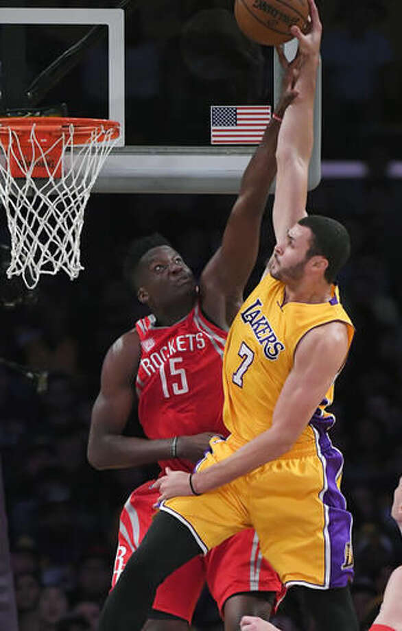 Los Angeles Lakers forward Larry Nance Jr., right, shoots as Houston Rockets center Clint Capela, of Switzerland, defends during the first half of an NBA basketball game, Wednesday, Oct. 26, 2016, in Los Angeles. (AP Photo/Mark J. Terrill)