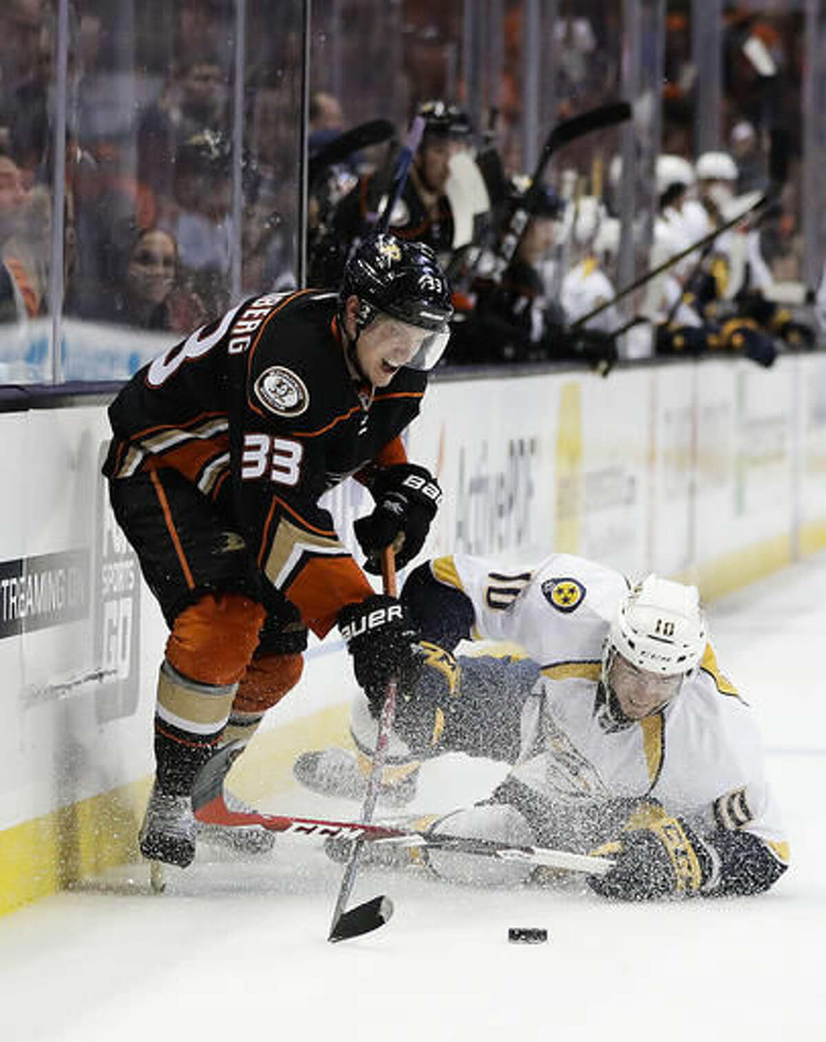 Nashville Predators' Colton Sissons, right, falls to the ice as he defends Anaheim Ducks' Jakob Silfverberg, of Sweden, during the second period of an NHL hockey game Wednesday, Oct. 26, 2016, in Anaheim, Calif. (AP Photo/Jae C. Hong)