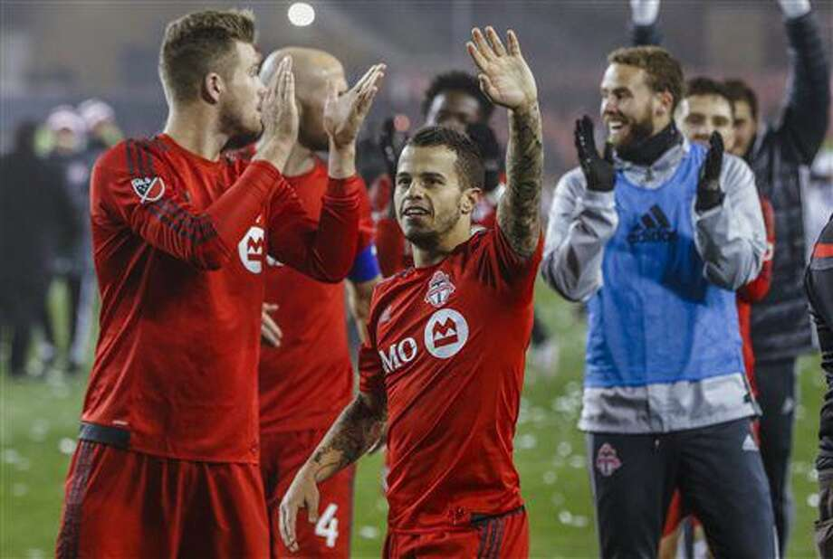 Toronto FC's Sebastian Giovinco waves to the crowd after his team defeated the Philadelphia Union in an MLS soccer playoff match in Toronto, Wednesday, Oct. 26, 2016. (Mark Blinch/The Canadian Press via AP)