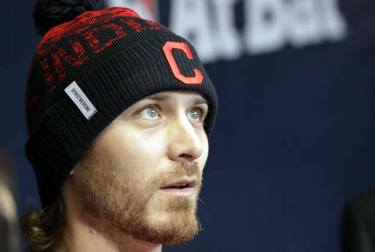 In this Wednesday, Oct. 26, 2016 photo, Cleveland Indians starting pitcher Josh Tomlin talks to reporters in the dugout before Game 2 of the Major League Baseball World Series against the Chicago Cubs in Cleveland. As a kid, while his dad sat on a bucket in their backyard to catch his pitches, Tomlin used to pretend he was pitching in the World Series. On Friday he gets to do that for real, he's scheduled to pitch Game 3 in Chicago. (AP Photo/David J. Phillip)