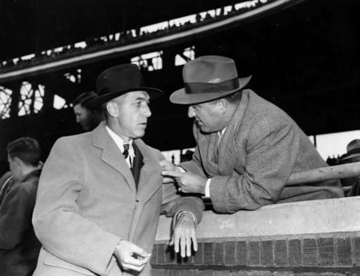 FILE - In this Oct. 10, 1945, file photo, baseball commissioner A.B. Chandler, right, talks with National League President Ford Frick before the final World Series game in Chicago, Ill. (AP Photo/File)