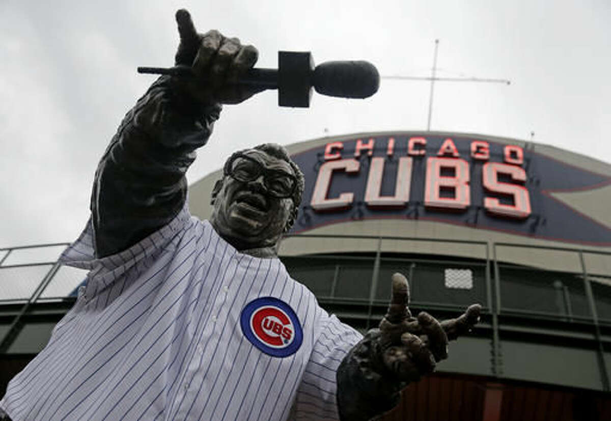 FILE - in this Oct. 6, 2016 file photo, the statue of Hall of Fame Chicago Cubs broadcaster Harry Caray, wears a Cubs jersey outside Wrigley Field before a baseball workout in Chicago. Not since Oct. 10, 1945, has a World Series game been played at Wrigley Field in Chicago. As the World Series shifts to Chicago this weekend, all eyes are on the second-oldest ballpark in the major leagues. (AP Photo/Nam Y. Huh File)