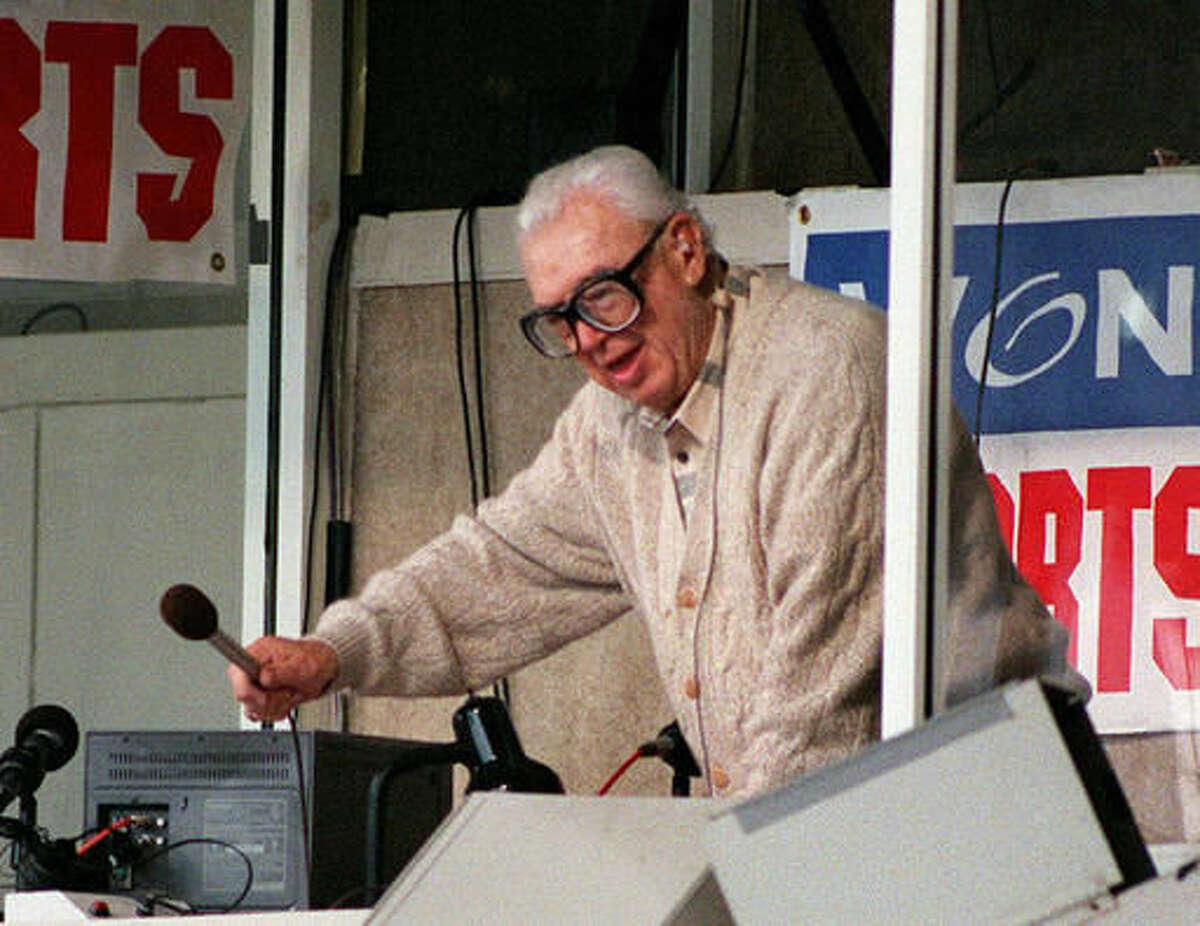 """FILE - In this June 11, 1997 file photo, Chicago Cubs announcer Harry Caray leads fans in singing """"Take Me Out to the Ball Game"""" during the seventh-inning stretch at a Cubs game at Wrigley Field in Chicago. Not since Oct. 10, 1945, has a World Series game been played at Wrigley Field in Chicago. As the World Series shifts to Chicago this weekend, all eyes are on the second-oldest ballpark in the major leagues. (AP Photo/Milwaukee Journal Sentinel, Benny Sieu, File)"""