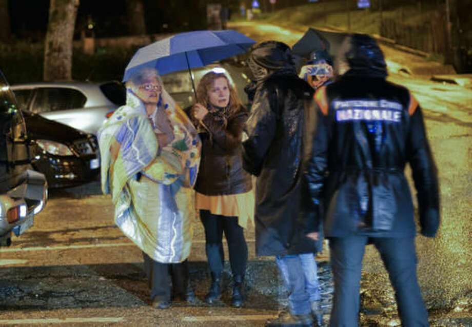 Residents of Ussita in central Italy, prepare to spend the night in tents under pouring rain, early Thursday, Oct 27, 2016, following a 5.9 earthquake that destroyed part of their neighborhood. A pair of strong aftershocks shook central Italy late Wednesday, crumbling churches and buildings, knocking out power and sending panicked residents into the rain-drenched streets just two months after a powerful earthquake killed nearly 300 people. (AP Photo/Sandro Perozzi)