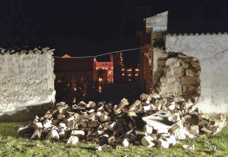 A view of the damaged cemetery of Castelsantangelo sul Nera, Italy, Wednesday, Oct 26, 2016 following an earthquake. A pair of strong aftershocks shook central Italy late Wednesday, crumbling churches and buildings, knocking out power and sending panicked residents into the rain-drenched streets just two months after a powerful earthquake killed nearly 300 people. (AP Photo/Sandro Perozzi)