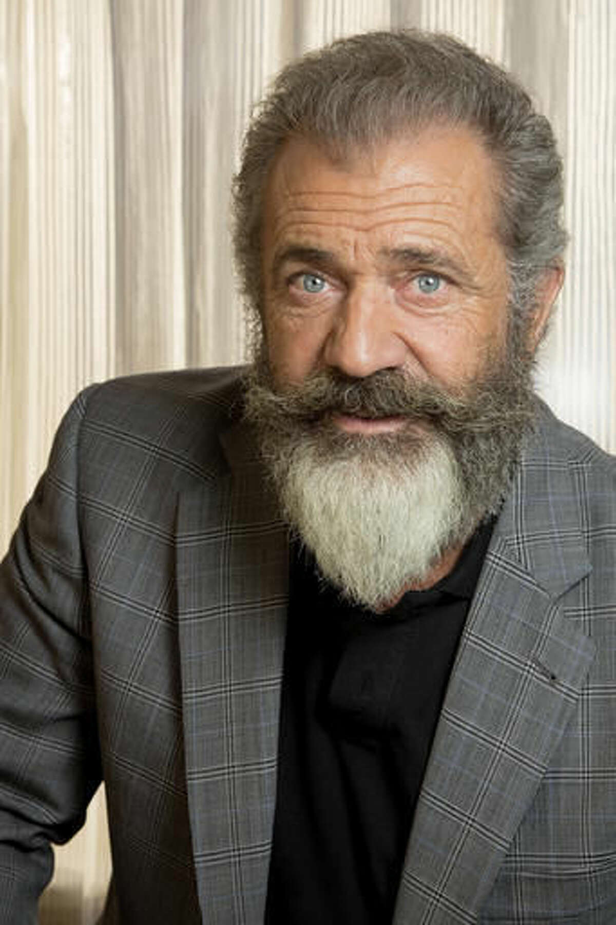 """Mel Gibson poses for a photo at the Ritz Carlton in New Orleans, Wednesday, Oct. 26, 2016. Gibson directed a film about Congressional Medal of Honor recipient Desmond Doss in a new movie titled, """"Hacksaw Ridge."""" (AP Photo/Max Becherer)"""