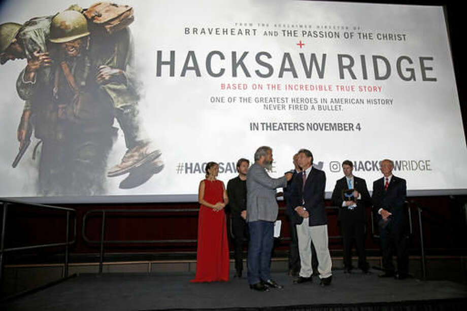 """Director Mel Gibson, center, interviews Desmond Doss Jr., the son of Congressional Medal of Honor recipient Desmond Doss, at a screening of the movie """"Hacksaw Ridge"""" at The National WWII Museum, in New Orleans, Wednesday, Oct. 26, 2016. The film depicts the life of conscientious objector and Congressional Medal of Honor recipient, Desmond Doss. (AP Photo/Max Becherer)"""