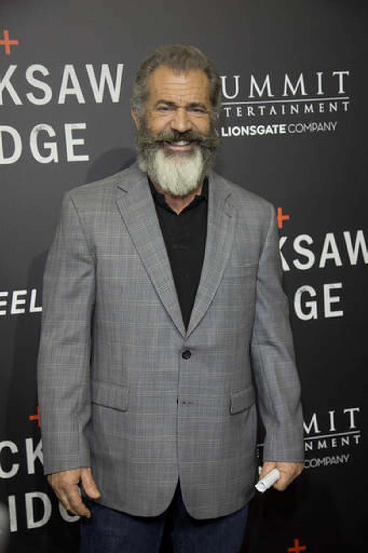 """Director Mel Gibson poses on the red carpet for the premiere of his movie """"Hacksaw Ridge,"""" at The National WWII Museum, in New Orleans, Wednesday, Oct. 26, 2016. The film depicts the life of World War II medic and Congressional Medal of Honor recipient Desmond Doss. (AP Photo/Max Becherer)"""