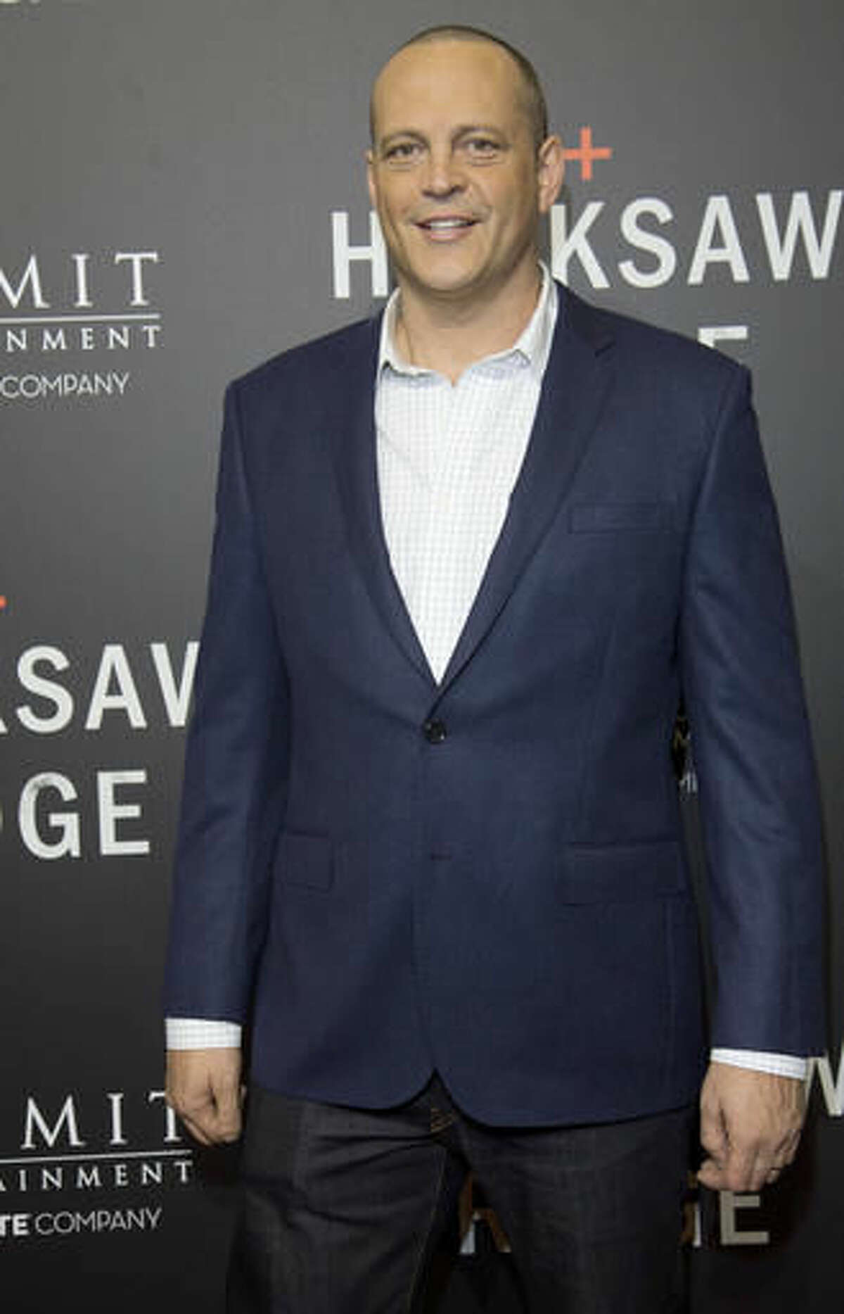 """Actor Vince Vaughn poses on the red carpet for the premier of the movie """"Hacksaw Ridge"""" at The National WWII Museum, in New Orleans, Wednesday, Oct. 26, 2016. The film depicts the life of World War II medic and Congressional Medal of Honor recipient Desmond Doss. (AP Photo/Max Becherer)"""