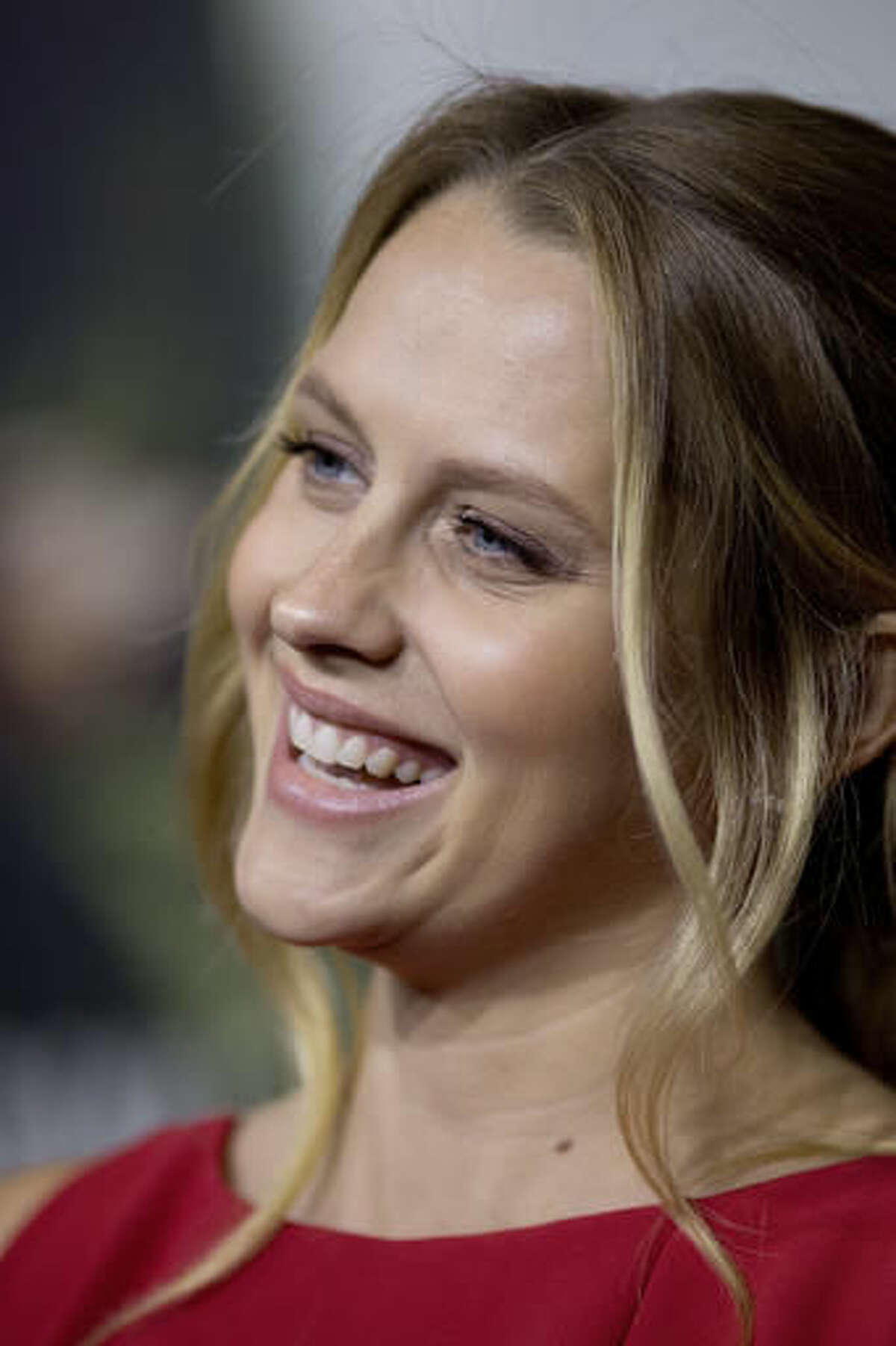 """Actress Teresa Palmer poses on the red carpet for a screening of the movie """"Hacksaw Ridge,"""" at The National WWII Museum, in New Orleans, Wednesday, Oct. 26, 2016. Palmer plays the role of Dorothy Schutte. The film depicts the life of World War II medic and Congressional Medal of Honor recipient Desmond Doss. (AP Photo/Max Becherer)"""