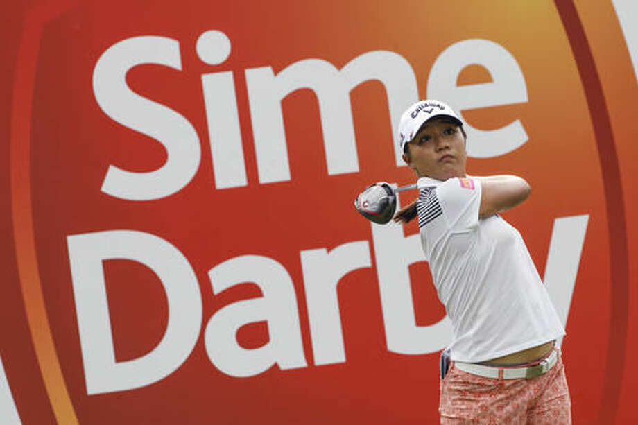 Lydia Ko of New Zealand follows her shot on the eighth hole during the first round of the LPGA golf tournament at Tournament Players Club (TPC) in Kuala Lumpur, Malaysia, Thursday, Oct. 27, 2016. (AP Photo/Joshua Paul)