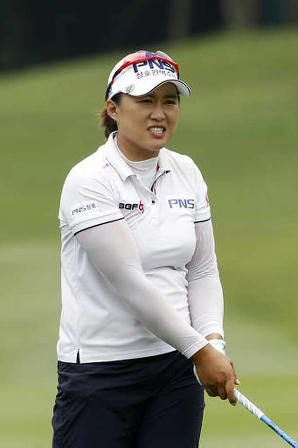 Amy Yang of South Korea reacts after hitting her shot on the 12th hole during the first round of the LPGA golf tournament at Tournament Players Club (TPC) in Kuala Lumpur, Malaysia, Thursday, Oct. 27, 2016. (AP Photo/Joshua Paul)