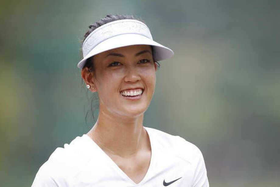 Michelle Wie of the United States smiles as she approaches the seventh hole during the first round of the LPGA golf tournament at Tournament Players Club (TPC) in Kuala Lumpur, Malaysia, Thursday, Oct. 27, 2016. (AP Photo/Joshua Paul)