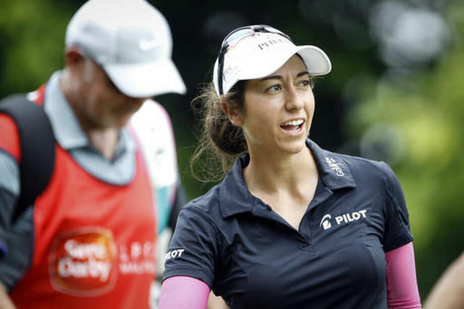 Marina Alex of the United States reacts after teeing off on the seventh hole during the first round of the LPGA golf tournament at Tournament Players Club (TPC) in Kuala Lumpur, Malaysia, Thursday, Oct. 27, 2016. (AP Photo/Joshua Paul)