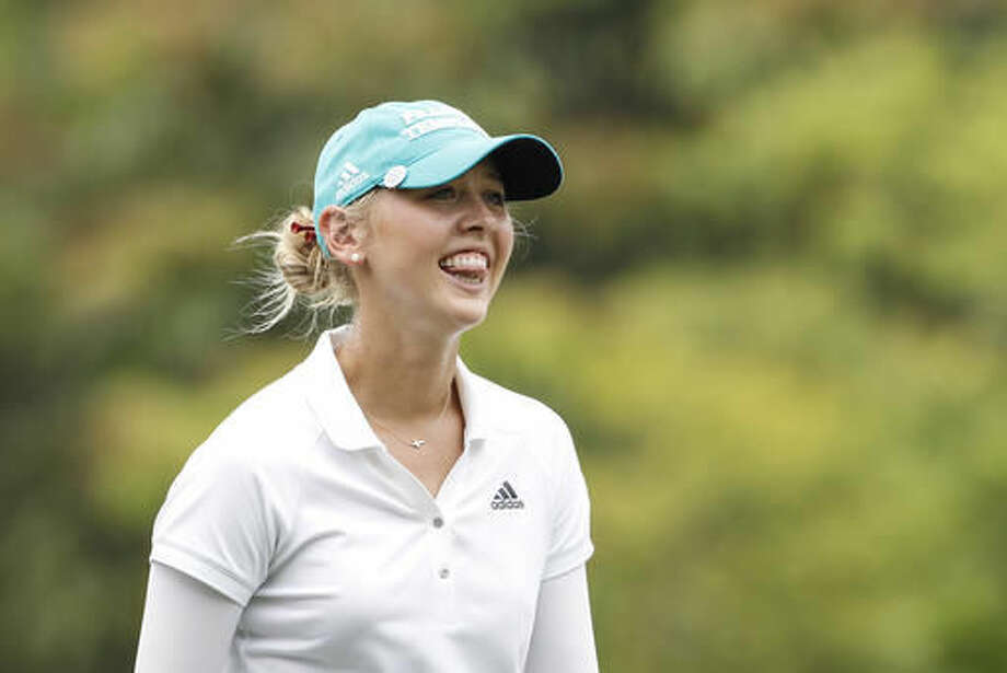 Jessica Korda of the United States bites her tongue as she walks towards the twelfth green during the first round of the LPGA golf tournament at Tournament Players Club (TPC) in Kuala Lumpur, Malaysia, Thursday, Oct. 27, 2016. (AP Photo/Joshua Paul)
