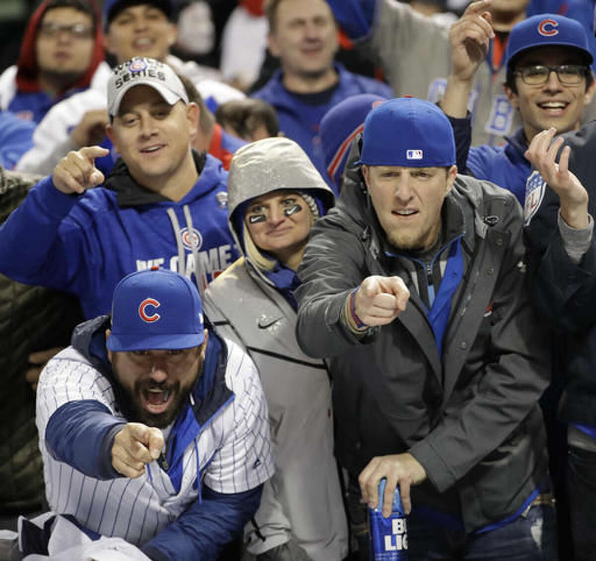 Chicago Cubs fans celebrate at Progressive Field after Game 2 of the Major League Baseball World Series against the Cleveland Indians Wednesday, Oct. 26, 2016, in Cleveland. The Cubs won 5-1 to tie the series 1-1. (AP Photo/David J. Phillip)