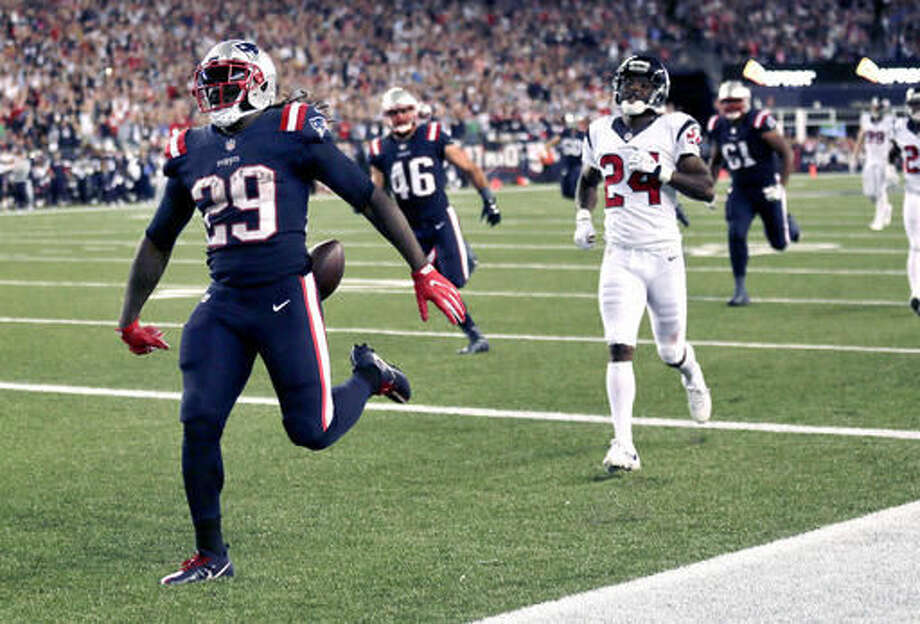 FILE - In this Sept. 22, 2016, file photo, New England Patriots running back LeGarrette Blount (29) runs into the end zone ahead of Houston Texans cornerback Johnathan Joseph (24) for a touchdown during the second half of an NFL football game in Foxborough, Mass. On Sunday, Oct. 30, 2016, the Buffalo Bills face a Patriots run attack led by Blount, who had a season-best 127 yards and scored twice in a 27-16 win at Pittsburgh. (AP Photo/Charles Krupa, File)