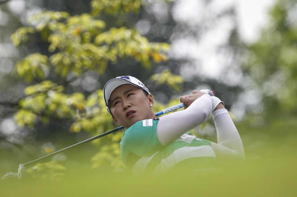 Amy Yang of South Korea follows her shot on the third hole during the second round of the LPGA golf tournament at Tournament Players Club in Kuala Lumpur, Malaysia, Friday, Oct. 28, 2016. (AP Photo/Joshua Paul)
